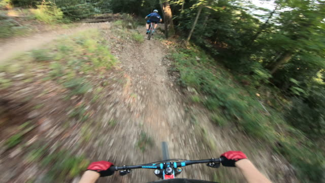 first person view of mountain bikers descending a trail - mountain bike stock videos & royalty-free footage