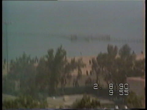 First pictures of Iraqi invasion Kuwait City 2890 excerpt of Kevin Hayden's video of Iraqi invasion of Kuwait pall of black smoke rising from...