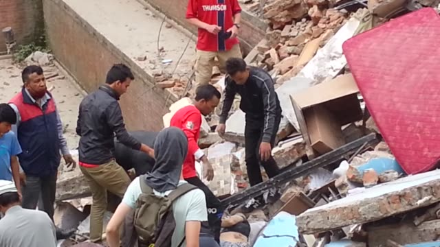 first rescue operations take place after a 7.9 magnitude earthquake struck kathmandu. the military, local people and tourists can all be seen helping... - kathmandu stock videos & royalty-free footage