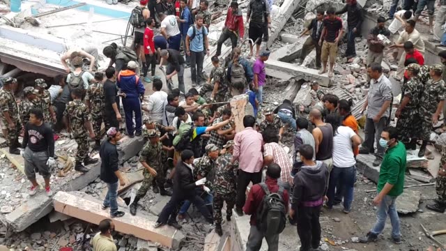 first rescue operations take place after a 7.9 magnitude earthquake struck kathmandu. the military, local people and tourists can all be seen helping... - nepal stock videos & royalty-free footage