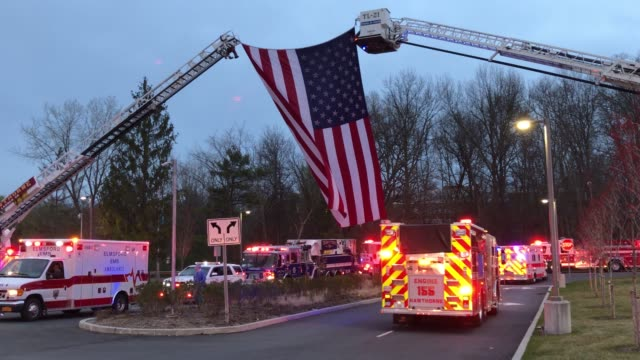 first responders from throughout westchester county arrived in ems ambulances fire department trucks and police vehicles to give thanks to healthcare... - thank you点の映像素材/bロール
