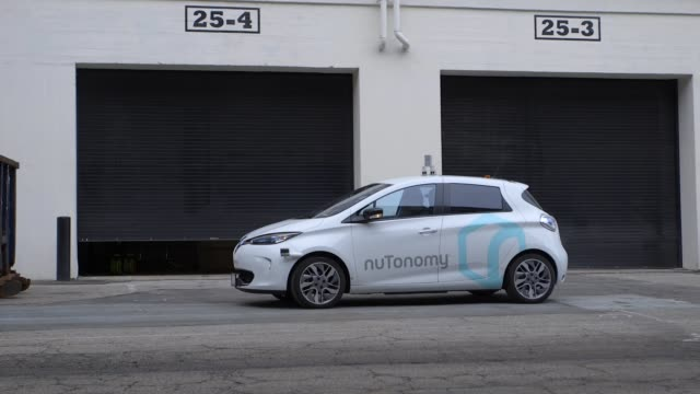 first selfdriving car hits the road in boston a white compact hatchback a renault zoe pulled out from a loading dock and zipped down an alley inside... - driverless car stock videos & royalty-free footage