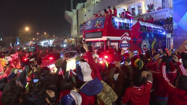 First time Copa America champions Chile leave the National Football stadium with cheering fans after their victory over Argentina