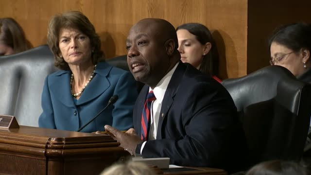 first up close and then wider to show the exchange, south carolina senator tim scott tells education secretary designate betsy devos that all must... - prisoner education stock videos & royalty-free footage