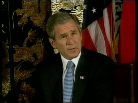 stockvideo's en b-roll-footage met shanghai president george w bush sitting down with japanese prime minister junichiro koizumi us president george w bush speaking sot heart goes out... - 2001