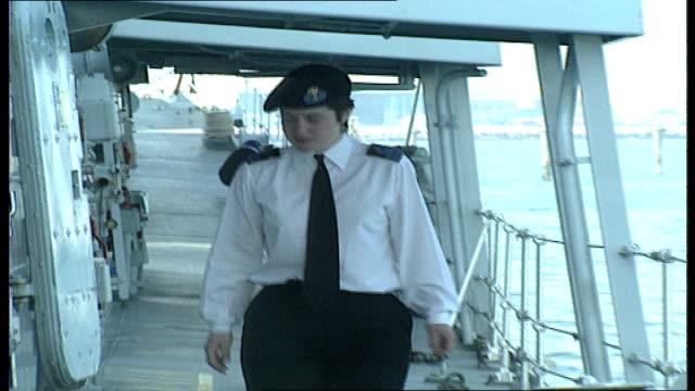40 EXT First Wren on HMS Norfolk chatting to crewmen Dorset on deck Wren and crewmen looking at piece of Portland equipment Wren walking along deck...
