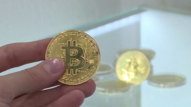first you ring then push through heavy doors past a suspicious security guard before arriving at moscow's pioneering cryptocurrency store a physical... - bitcoin stock videos & royalty-free footage