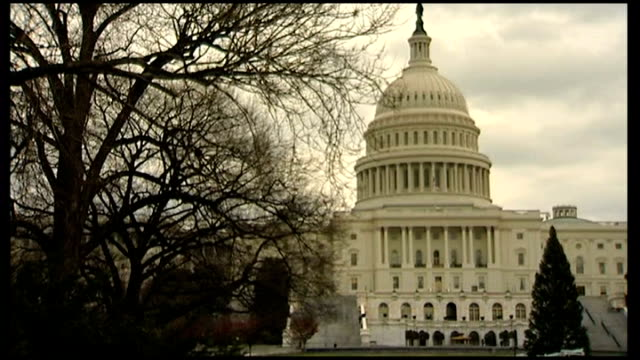 US Senate approves deal EXT General views of Capitol Building US flag flying from flagpole alongside