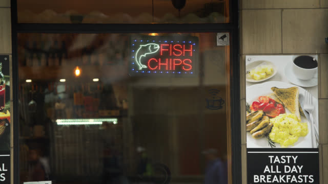fish and chip sign on shop front, edinburgh - shop sign stock videos & royalty-free footage