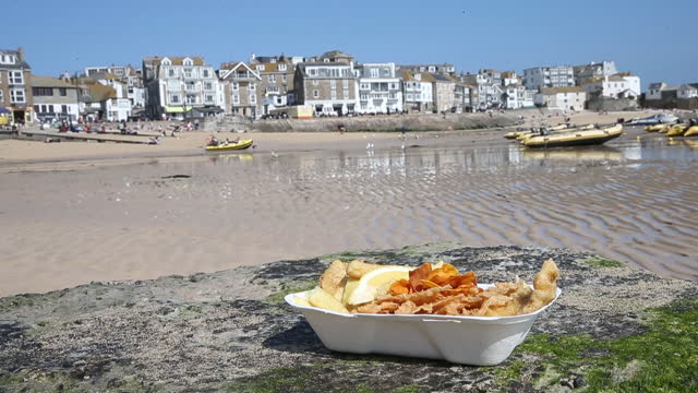 fish and chips against st ives townhouses as u.k. pickscornwallfor in person g7 summit in june, in st ives, cornwall, u.k., on friday and saturday,... - citrus fruit stock videos & royalty-free footage