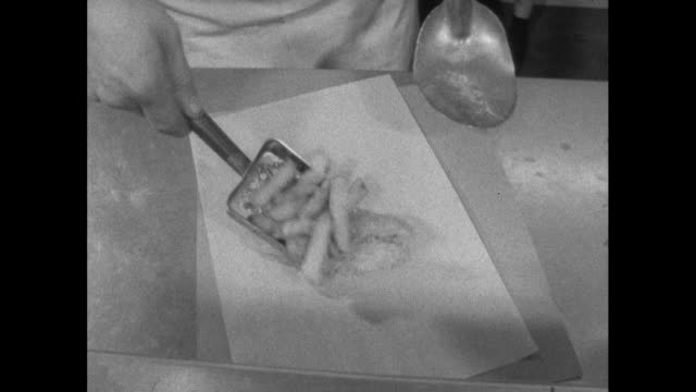 fish and chips being wrapped in paper; 1964 - fast food stock videos & royalty-free footage
