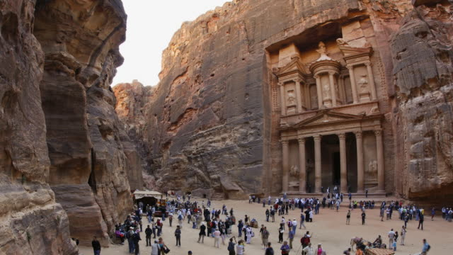 T/L, WS, ZO, fish eye, fast moving people outside the Al Khazneh (Treasury) at ancient stone city of Petra / Jordan