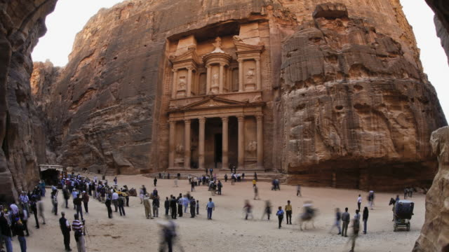 T/L, WS, ZI, fish eye, fast moving people outside the Al Khazneh (Treasury) at ancient stone city of Petra / Jordan