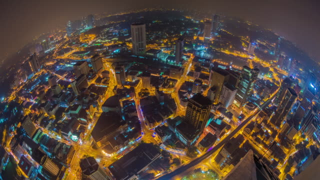 Fish eye time lapse looking down on KL's streets at daybreak