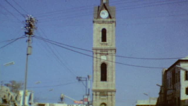 fish market / jaffa clock tower / flea market / street vendor / playing backgammon / port city of jaffa on september 01 1974 in jaffa israel - 1974 stock videos and b-roll footage