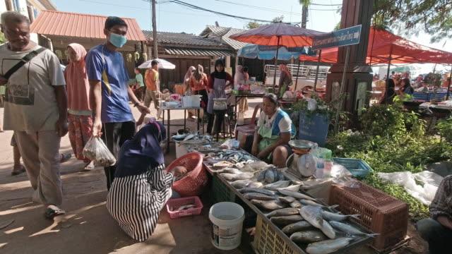 fish market street stall seller vendor outdoor thailand - thailand stock videos & royalty-free footage