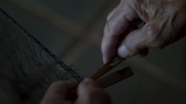 fish net  by hand - ball of wool stock videos & royalty-free footage