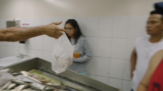 fish shop - dubai - plastic bag stock videos and b-roll footage
