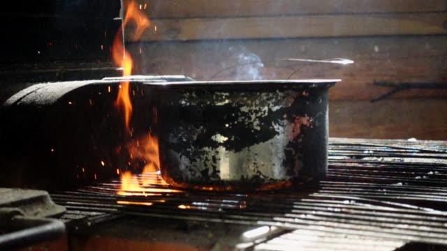 Fish soup campfire