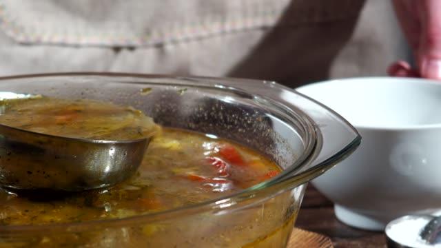 fish soup - mestolo video stock e b–roll