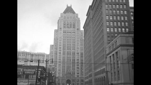 fisher building in detroit, with bus passing in foreground / vs fisher building and other buildings in the new center area of detroit / tilt up... - general motors stock videos & royalty-free footage