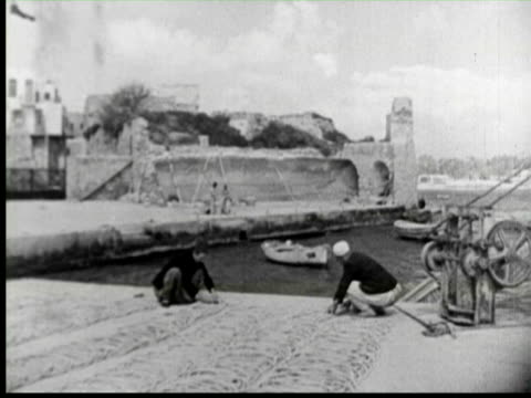 b/w fisher man using various way of fishing, palestine / audio - palestine stock videos and b-roll footage