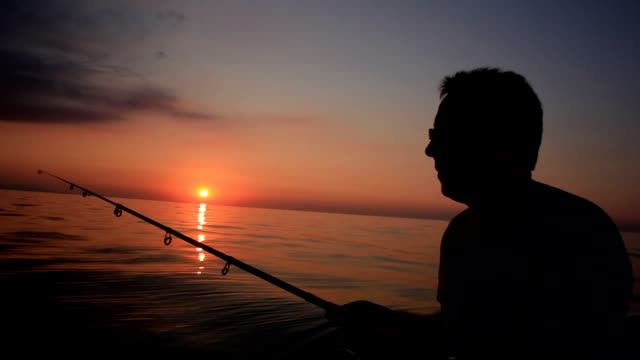 fisherman and sundown - hook stock videos and b-roll footage