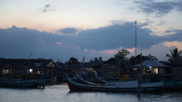 Fisherman arrive to port with the day's catch in Kurau village Central Bangka Bangka Island Indonesia on Tuesday July 28 2015 Shots pan right of...