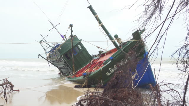 Fisherman boat aground in Thailand