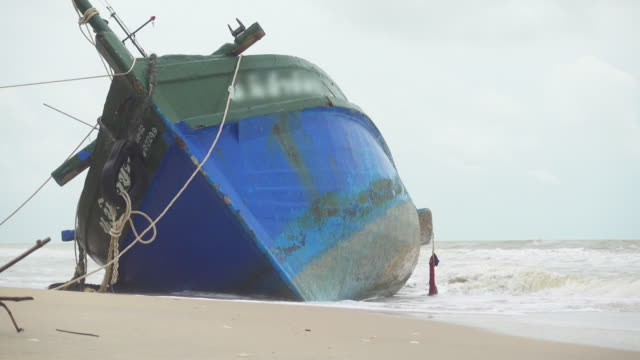 fisherman boat aground in thailand - shipwreck stock videos and b-roll footage
