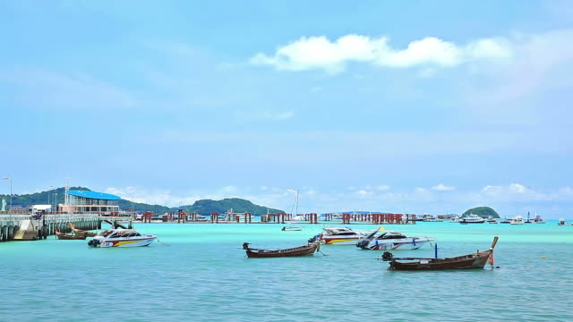 stockvideo's en b-roll-footage met fisherman boat  floating in chalong bay beach phuket thailand - passagiersboot