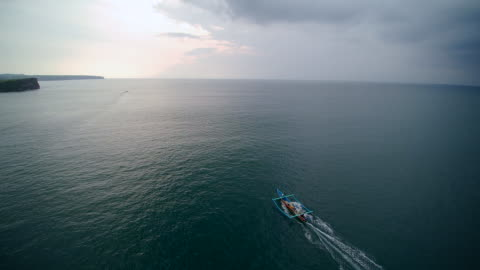 fisherman boat sailing sunset bali - 40 seconds or greater stock videos & royalty-free footage