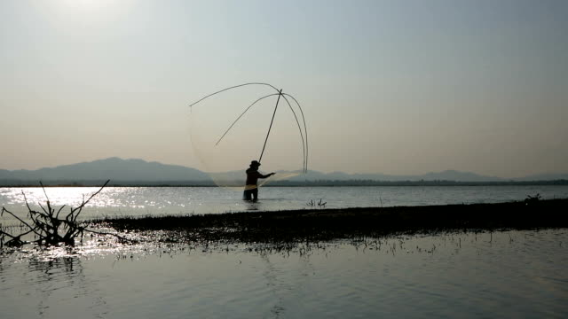 fisherman casting fish with fishing net - casting stock videos & royalty-free footage