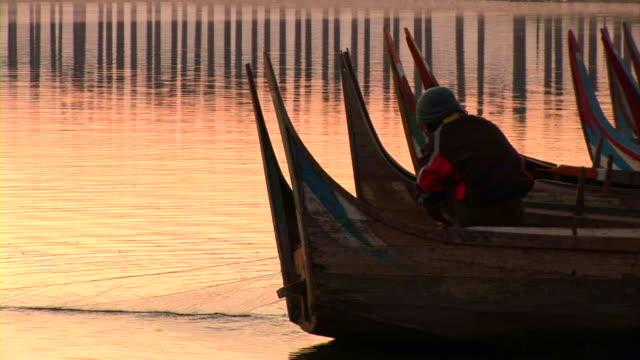 Fisherman collecting fishing net