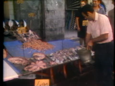 fisherman continue working at the docks in spite of the cholera outbreak in naples. - vibrio stock videos & royalty-free footage