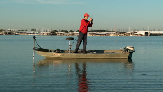 Fisherman Drifting On Boat