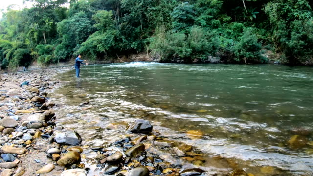 rt fisherman fishing blue mahseer. - southeast asian ethnicity stock videos & royalty-free footage