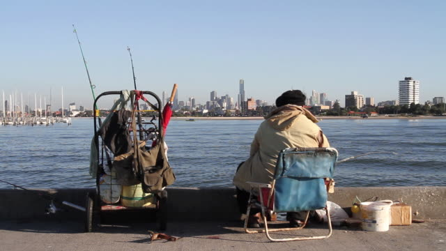 ms fisherman fishing from dock / melbourne, victoria, australia - chair stock videos and b-roll footage
