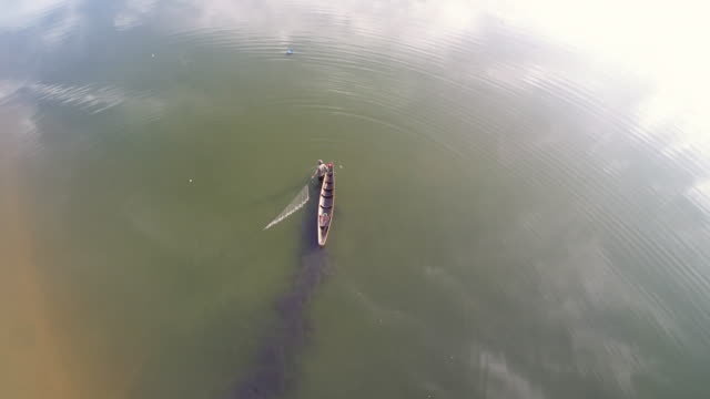 Fisherman fishing in Artificial lake lhokseumawe aceh
