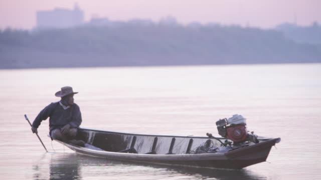 WS fisherman in boat on Mekong River / Vientiane, Laos