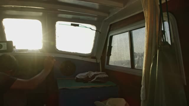 ms fisherman in fishing boat cabin - small boat stock videos & royalty-free footage
