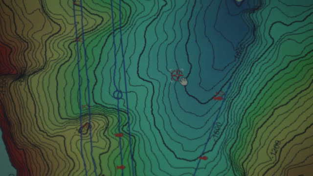 fisherman looks at bathymetric map on fishing boat - topography stock videos & royalty-free footage
