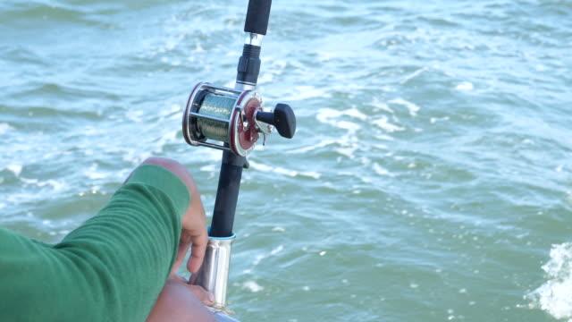 fisherman monitor rod with ocean background - canna da pesca video stock e b–roll