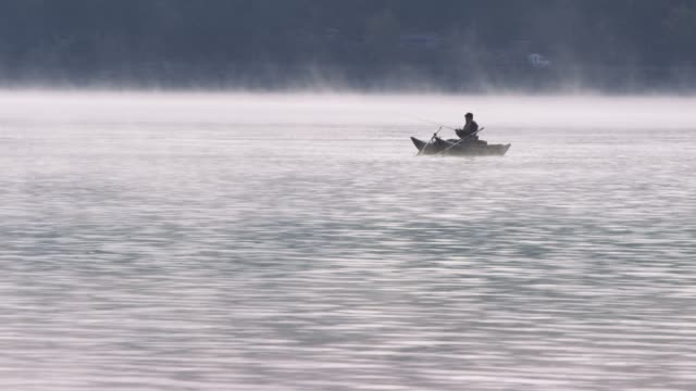 fisherman on boat, wide - wilderness stock videos & royalty-free footage