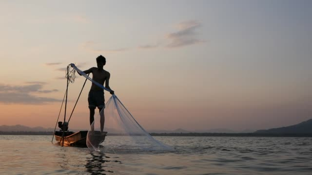 fisherman on longtail boat fishing in thailand - fisherman stock videos & royalty-free footage