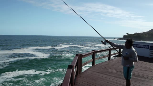 ms pan fisherman on the deck / rio de janeiro, brazil - fishing rod stock videos & royalty-free footage