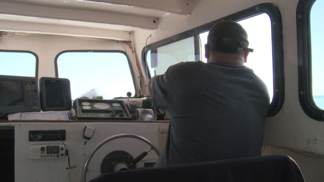 Fisherman pilots his boat on the Chesapeake Bay