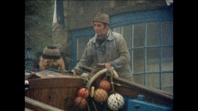 montage fisherman prepare their boats for launch / united kingdom - peter greenaway stock videos & royalty-free footage