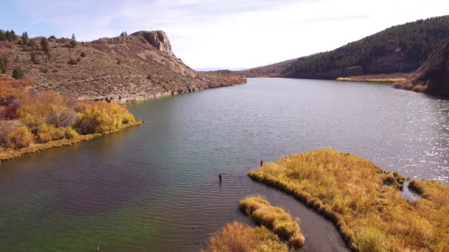 Fisherman Pull back, Mountain Reveal Fall colors Lake Reflection, Wildlife, Foliage SHORT Aerial, 4K, 7s, 68of96, Stock Video Sale - Drone Discoveries - drone aerial view