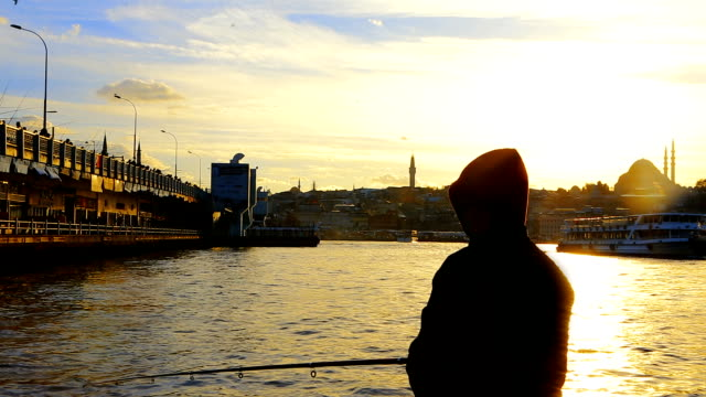 fisherman silhouette and the galata bridge - hooded top stock videos & royalty-free footage